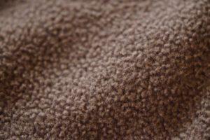 Mundschutz Schutzmaske Vlies Struktur Stoff Schaf Wolle