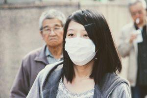 Mundschutz Maske Asiatin Frau Mann